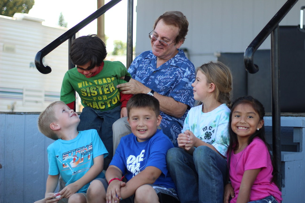 Joe Gandelman and John Raven meet some kids after one of the 13 family shows he did at the Nez Perce County Fair in Lewiston, Idaho in September 2015.